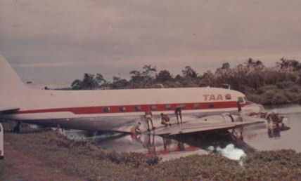 VH-PNB swimming at Madang.